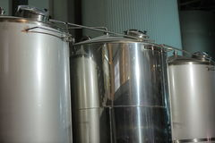 Equipment for production of beer in factory shops Stock Photography