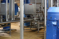 Equipment for production of beer in factory shops Royalty Free Stock Photos