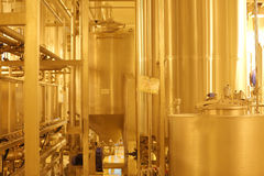 Equipment for production of beer in factory shops Royalty Free Stock Images