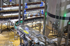 Equipment for production of beer in factory shops Stock Photos