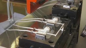 Equipment for the production of electrical network plugs. Production of forks on injection molding machine. Production of modern electric plug. close-up of stock footage