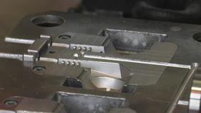 Equipment for the production of electrical network plugs. Production of forks on injection molding machine. Production of modern electric plug. close-up of stock video footage