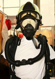 Equipment of rescuer. Helmet and protective mask with self-contained breathing apparatus Stock Photo