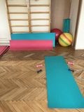 Equipment of the room of therapeutic physical training. Gym mats, balls and sticks Stock Image