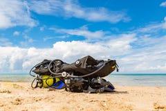 Equipment of a scuba diver, an oxygen balloon lies on the beach. Diving, equipment, fins, balloons, masks. Equipment of a scuba diver, an oxygen balloon lies on stock photo