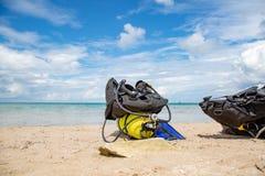 Equipment of a scuba diver, an oxygen balloon lies on the beach. Diving, equipment, fins, balloons, masks. Equipment of a scuba diver, an oxygen balloon lies on stock images