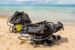 Equipment of a scuba diver, an oxygen balloon lies on the beach. Diving, equipment, fins, balloons, masks. Equipment of a scuba diver, an oxygen balloon lies on stock photography