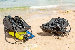 Equipment of a scuba diver, an oxygen balloon lies on the beach. Diving, equipment, fins, balloons, masks. Equipment of a scuba diver, an oxygen balloon lies on stock image