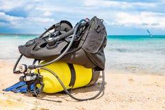 Equipment of a scuba diver, an oxygen balloon lies on the beach. Diving, equipment, fins, balloons, masks. Equipment of a scuba diver, an oxygen balloon lies on stock photos