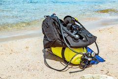 Equipment of a scuba diver, an oxygen balloon lies on the beach. Diving, equipment, fins, balloons, masks. Equipment of a scuba diver, an oxygen balloon lies on royalty free stock photos
