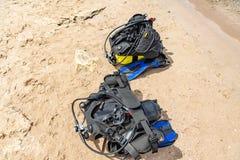 Equipment of a scuba diver, an oxygen balloon lies on the beach. Diving, equipment, fins, balloons, masks. Equipment of a scuba diver, an oxygen balloon lies on royalty free stock photography