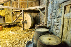 Equipment in the shed. Close up of wooden equipment, instruments and straw in the shed. Millstone interior Royalty Free Stock Photography