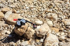 Mask and snorkel set on a rocky beach. Equipment for snorkeling mask and snorkel set on a rocky beach Stock Photo
