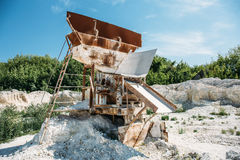Equipment for sorting and loading ore in a quarry. Construction site in mining chalk quarry Stock Photos