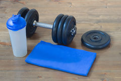 Equipment for sport blue. Sports items on the floor in the hall Royalty Free Stock Images