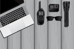 The equipment of a spy or private detective. Laptop, walkie-talkie, action camera, flashlight, sunglasses. Vector illustration EPS 10 Royalty Free Stock Photo