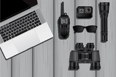The equipment of a spy or private detective. Laptop, walkie-talkie, action camera, flashlight, sunglasses and binoculars. Vector illustration EPS 10 Royalty Free Stock Photos