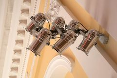 Equipment for stage lighting, hanging on the wall in the concert Royalty Free Stock Photo