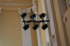 Equipment for stage lighting, hanging on the wall in the concert Stock Image