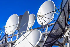 Equipment to connect satellite and cable services on the background of blue sky . Stock Photography