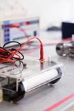 Equipment to run gels in modern laboratory. Scientific equipment background, focus on the red electric wire next to yellow sign. This is modern station to run Stock Images