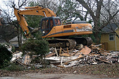 Equipment On Top Of Demolished House Royalty Free Stock Image