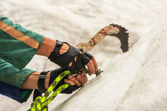 The climber mount the drill in ice Stock Photography