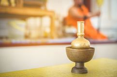 The equipment used in the rituals of Buddhism by the priests yellow dress, orange is the background blurred. royalty free stock photography