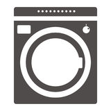 Equipment for washing clothes. Household appliances Modern washing machine isolated on purple background. Washer. Royalty Free Stock Photos