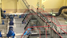 Equipment for water purification. Engines, pipeline, valves, gauges. Zoom out stock video footage