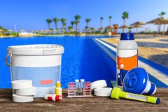 Free Equipment With Chemical Cleaning Products And Tools For The Maintenance Of The Swimming Pool. Stock Image - 152652241
