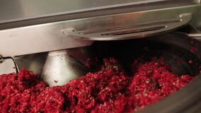 Equipment works with minced meat in sausage production shop