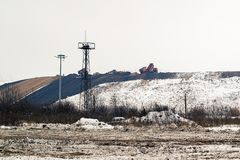 Equipment works in the process of waste disposal and landfill reclamation royalty free stock photography