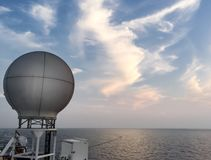 Equipments and navigation system on backdesk in seismic vessel ship. During sunset in Andaman Sea for oil and gas survey with sky background Stock Photo