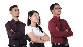Equipo asiático del negocio que mira fijamente para arriba Fotos de archivo