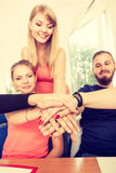 Equipo de amigos que muestran la unidad con sus manos junta Imagen de archivo libre de regalías