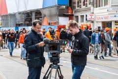 Equipo de cámara en el collage 2013 de Koninginnedag Imagen de archivo