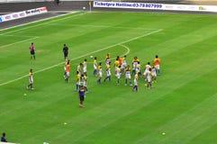Equipo de fútbol de Malasia y de Liverpool Imágenes de archivo libres de regalías