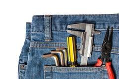 equipo de herramienta en bolsillo de la mezclilla imagen de archivo libre de regalías