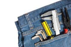 equipo de herramienta en bolsillo de la mezclilla fotografía de archivo libre de regalías