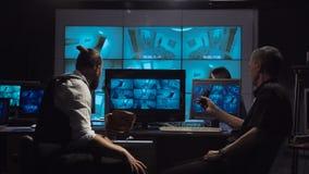 Equipo de la vigilancia de la oficina metrajes