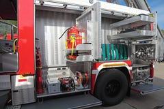 Equipo del coche de bomberos Imagenes de archivo