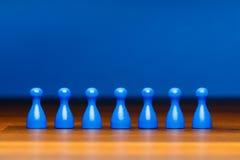 Equipo del concepto, negocio, organización, azul en la madera Fotografía de archivo libre de regalías
