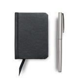 Equipo del cuaderno y de la pluma Imágenes de archivo libres de regalías
