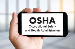 Equipo del negocio del OSHA de la Occupational Safety and Health Administration fotografía de archivo