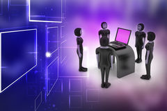 Equipo del negocio que mira un ordenador portátil Foto de archivo
