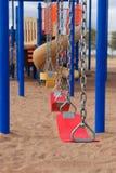 Equipo del patio de la escuela o del parque con los oscilaciones Imagen de archivo libre de regalías