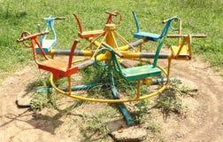 Equipo del patio el carrusel en el parque Foto de archivo libre de regalías