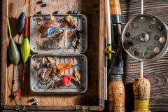 Equipo del pescador con la caña de pescar y señuelos Imágenes de archivo libres de regalías