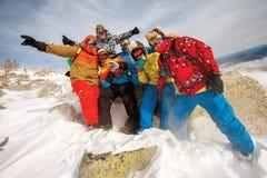 Equipo feliz de la snowboard Imagenes de archivo